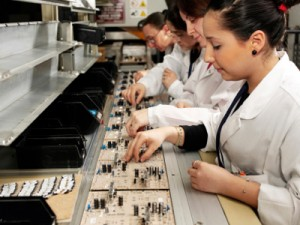 Assembly services for OEM companies. Employees assembling electric components