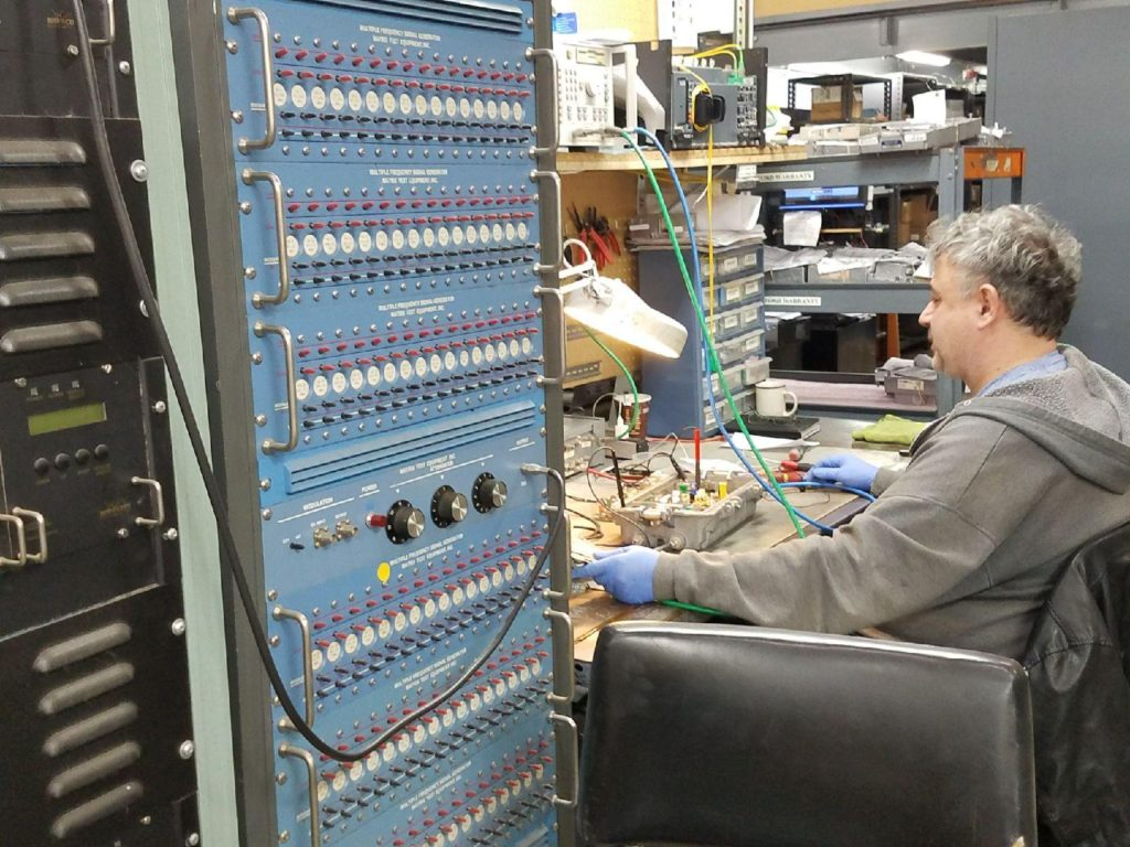 cable distribution repair equipment employee working on testing a component