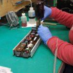 employee working on repairing telecom equipment